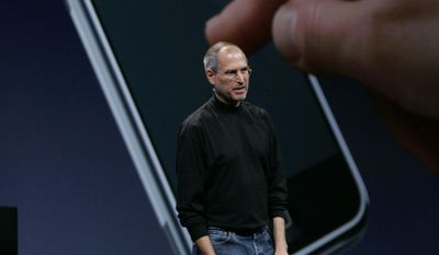 Apple CEO Steve Jobs talks about the new iPhone during his keynote address at MacWorld Conference & Expo in San Francisco, Tuesday, Jan. 9, 2007. (AP Photo/Paul Sakuma)