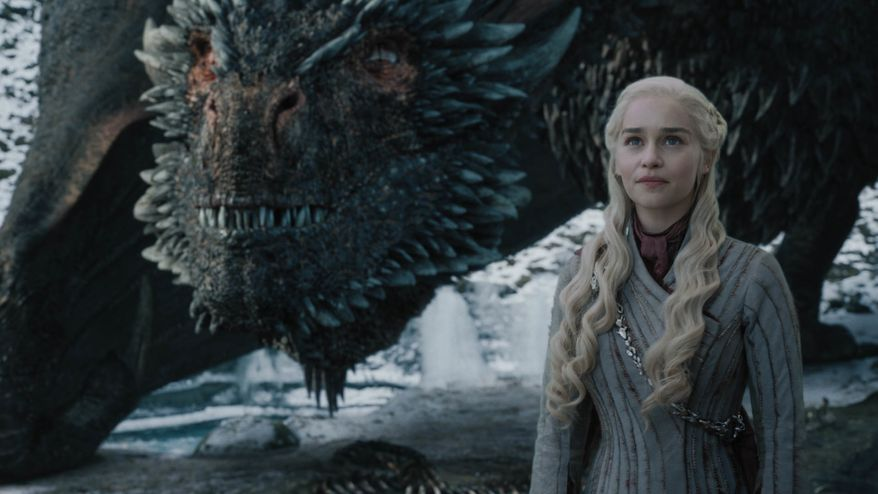 """This image released by HBO shows Emilia Clarke in a scene from """"Game of Thrones,"""" that aired Sunday, May 5, 2019. In the third to last episode of HBOs Game of Thrones, Mother of Dragons Daenerys Targaryen is suffering from a crisis of confidence. She is short on troops and dragons, short on strategies and short on friends. And her claim to the Iron Throne has weakened upon learning that Jon Snow, in fact, shares her royal Targaryen blood. (Helen Sloan/HBO via AP)"""