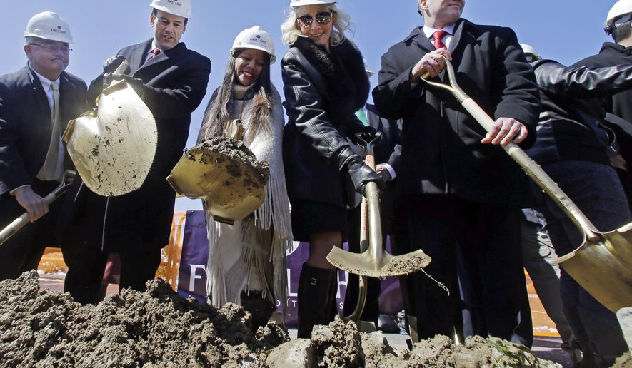 Officials wield shovels, including from third left, Tribal Council member Winnie Johnson Graham, state representative Shaunna O'Connell, and Taunton Mayor Thomas Hoye during an official groundbreaking, Tuesday, April 5, 2016, in Taunton, Mass., where the Mashpee Wampanoag tribe will build a resort casino that it hopes will become Massachusetts' first Las Vegas-style resort. The First Light casino, hotel and entertainment complex will be built on an industrial park that's part of the Cape Cod-based tribe's recently designated federal reservation. (AP Photo/Elise Amendola)