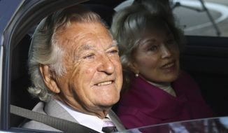 In this September 2013 file photo, former Australian Prime Minister Bob Hawke, left, and his wife Blanche d'Alpuget arrive at the Australian Labor Party's campaign launch in Brisbane, Australia. Hawke, Australia's 23rd prime minister, has died in Sydney at age 89. (AP Photo/Tertius Pickard, File)