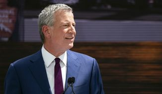 Democratic presidential candidate New York Mayor Bill de Blasio speaks during the official dedication ceremony of the Statue of Liberty Museum on Liberty Island Thursday, May 16, 2019, in New York. (AP Photo/Craig Ruttle)