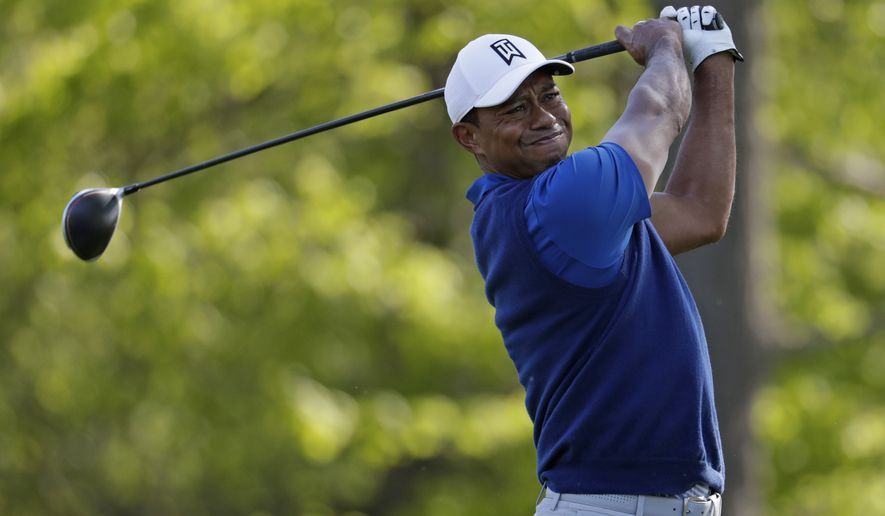 Tiger Woods tees off on the 13th hole during the first round of the PGA Championship golf tournament, Thursday, May 16, 2019, at Bethpage Black in Farmingdale, N.Y. (AP Photo/Julio Cortez) ** FILE **