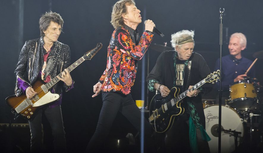 """In this Oct. 22, 2017, file photo from left, Ronnie Wood, Mick Jagger, Keith Richards and Charlie Watts of the Rolling Stones perform during the concert of their """"No Filter"""" Europe Tour 2017 at U Arena in Nanterre, outside Paris. The Rolling Stones are ready to get back on the road after postponing their North American tour because Mick Jagger needed medical treatment, reportedly for a heart valve issue. The rockers on Thursday, May 16, 2019, announced the No Filter tour will kick off in Chicago with two shows on June 21 and 25. (AP Photo/Michel Euler, File)"""