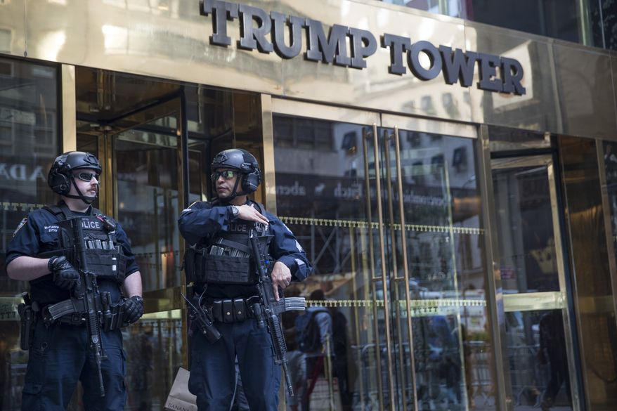 Heavily armed police officers stand guard outside Trump Tower, Thursday, May 16, 2019, in New York. President Donald Trump is attending a fund raiser in New York City Thursday and will spend the night at Trump Tower. (AP Photo/Mary Altaffer)