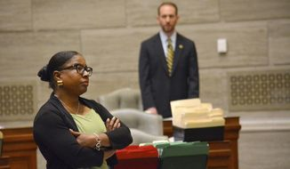 During debate in the Missouri Senate in Jefferson City Wednesday, May 15, 2019, freshman Sen. Karla May, D-St. Louis, listens to opposing arguments regarding Missouri's proposed new abortion law. Opponents of the bill have begun efforts to block it in that legislative body. The bill would prohibit an abortion after the unborn baby's heartbeat is detected. (Sally Ince/The Jefferson City News-Tribune via AP)