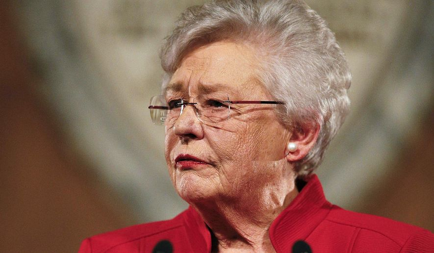 In this Jan. 9, 2018, file photo, Alabama Gov. Kay Ivey delivers the annual State of the State address at the Capitol in Montgomery, Ala. Ivey signed the nation's strictest abortion ban into law on Wednesday, May 15, 2019, making performing an abortion a felony in nearly all cases, punishable by up to life in prison, and with no exceptions for rape and incest.  (AP Photo/Brynn Anderson, File)