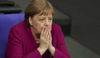 German Chancellor Angela Merkel, right, attends a debate on '70 Years German Constitution' of the German federal parliament, Bundestag, at the Reichstag building in Berlin, Germany, Thursday, May 16, 2019. (AP Photo/Michael Sohn)