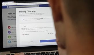 In this March 26, 2018, file photo, a man poses for photos in front of a computer showing Facebook ad preferences pages in San Francisco. The state Senate Appropriations Committee failed to advance a bill, by Sen. Hannah-Beth Jackson, D-Santa Barbara, to expand the state's new data privacy law and allow consumers to take companies to court over violations Thursday. (AP Photo/Jeff Chiu, File) **FILE**