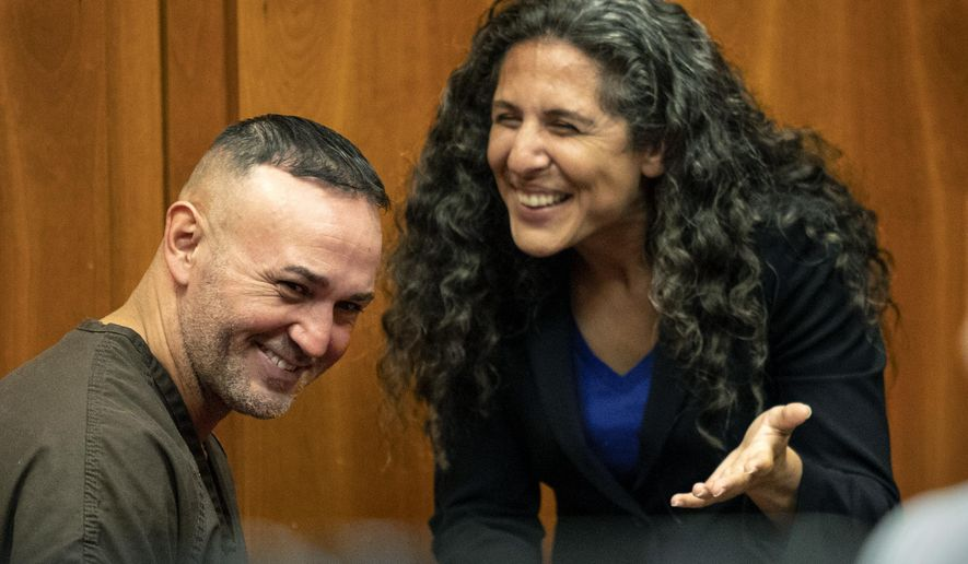 In this Wednesday, May 15, 2019 photo, Lionel Rubalcava talks with Northern California Innocence Project lead attorney Paige Kaneb before his attempted murder conviction was dismissed by a judge in San Jose, Calif. Rubalcava, a Northern California man wrongfully convicted in a 2002 drive-by shooting that left a man paralyzed, was exonerated and freed after 17 years in prison.  (Karl Mondon/San Jose Mercury News via AP)