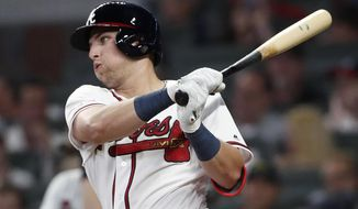 CORRECTS TO FIFTH INNING, INSTEAD OF SIXTH - Atlanta Braves' rookie Austin Riley follows through on a base hit in the fifth inning of the team's baseball game against the St. Louis Cardinals on Thursday, May 16, 2019, in Atlanta. (AP Photo/John Bazemore)