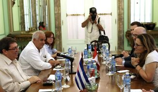 """Cuba's Foreign Minister Bruno Rodriguez, left, and Canada's Foreign Minister Chrystia Freeland, right, meet in Havana, Cuba, May 16, 2019. Freeland's office says the purpose of the visit is """"to discuss the deteriorating situation"""" in Cuba's ally Venezuela, as well as tightened U.S. sanctions on Cuba. (Alexandre Meneghini/Pool Photo via AP)"""