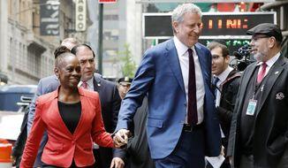"""New York Mayor Bill de Blasio and his wife Chirlane McCray arrive at """"Good Morning America"""" in New York, Thursday, May 16, 2019. De Blasio announced Thursday that he will seek the Democratic nomination for president, adding his name to an already long list of candidates itching for a chance to take on Donald Trump. (AP Photo/Richard Drew)"""