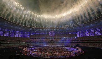 """FILE - In this Sunday, June 28, 2015 file photo, fireworks explode above the Baku Olympic stadium in Baku, Azerbaijan, during the closing ceremony of the 2015 European Games. Arsenal says the choice of Azerbaijan capital Baku to host the Europa League final has caused """"unacceptable"""" and """"extreme"""" travel problems for fans. Arsenal and Chelsea have been given just 6,000 tickets each by UEFA for the May 29, 2019 game, in a stadium with a capacity of 68,700. Arsenal says even those tickets may not sell out because of the difficulty of getting to Azerbaijan. (AP Photo/Dmitry Lovetsky, File)"""