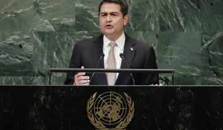 FILE - In this Sept. 26, 2018, file photo, Honduran President Juan Orlando Hernandez addresses the 73rd session of the United Nations General Assembly at the United Nations headquarters. Recently unsealed testimony shows that a brother of the Honduran president admitted to U.S. federal agents that he'd accepted presents from violent drug traffickers he'd known for years and once asked Honduran officials about money the government allegedly owed the traffickers. (AP Photo/Frank Franklin II, File)