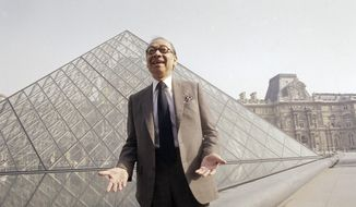In this March 29, 1989, file photo, Chinese-American architect I.M. Pei laughs while posing for a portrait in front of the Louvre glass pyramid, which he designed, in the museum's Napoleon Courtyard, prior to its inauguration in Paris. Pei, the globe-trotting architect who revived the Louvre museum in Paris with a giant glass pyramid and captured the spirit of rebellion at the multi-shaped Rock and Roll Hall of Fame, has died at age 102, a spokesman confirmed Thursday, May 16, 2019. (AP Photo/Pierre Gleizes, File)