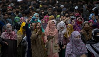 Kashmiri village women shout pro freedom slogans as they participate in funeral procession of top rebel commander Naseer Pandith, in Pulwama, south of Srinagar, Indian controlled Kashmir, Thursday, May 16, 2019. Three rebels, an army soldier and a civilian were killed early Thursday during a gunbattle in disputed Kashmir that triggered anti-India protests and clashes, officials and residents said. (AP Photo/ Dar Yasin)