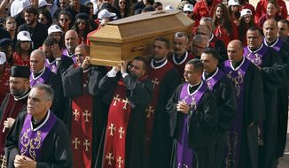 Clergymen carry the coffin of former Maronite Patriarch Cardinal Mar Nasrallah Boutros Sfeir, during his funeral Mass, at the seat of the Maronite Church, in the village of Bkirki, north of Beirut, Lebanon, Thursday, May 16, 2019. Sfeir, who served as spiritual leader of Lebanon's largest Christian community through some of the worst days of the country's 1975-1990 civil war, died Sunday. (AP Photo/Bilal Hussein)