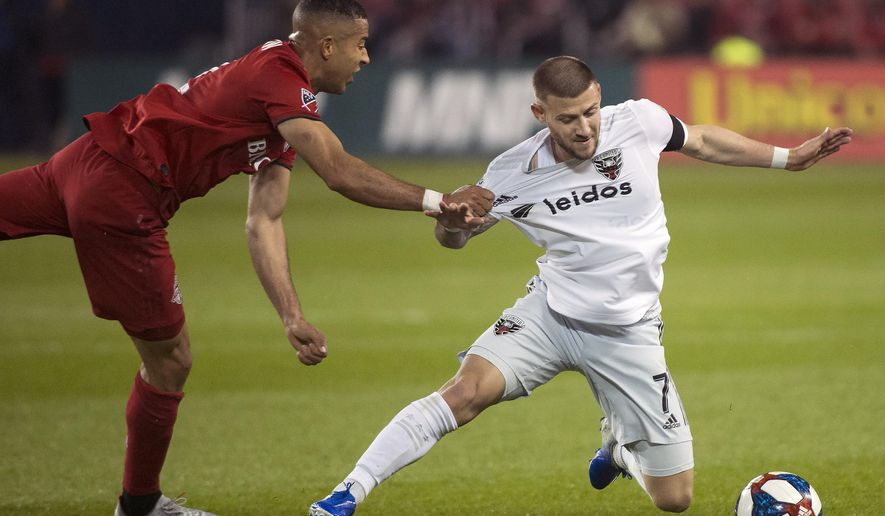 Toronto FC defender Justin Morrow (2) pulls down D.C. United forward Paul Arriola (7) during the second half of an MLS soccer game, Wednesday, May 15, 2019 in Toronto. (Nathan Denette/The Canadian Press via AP) ** FILE **