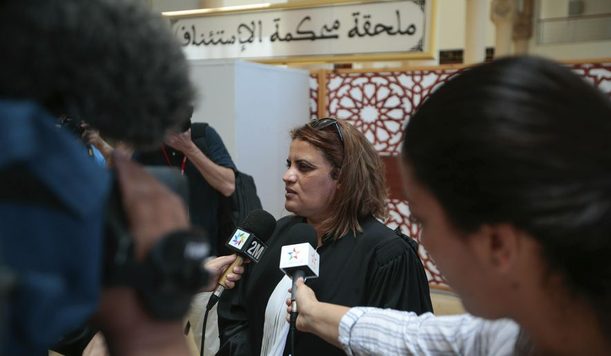 Hafida Makssaoui, a state lawyer representing four suspects.speaks to the press after a trial session for suspects charged in connection with killing of two Scandinavian tourists in Morocco's Atlas Mountains, in Sale, near Rabat, Morocco, Thursday, May 16, 2019. Twenty-four people have gone on trial on Moroccan terrorism charges over a brutal killing of two Scandinavian women hikers that rocked Denmark, Norway and Morocco itself. (AP Photo/Mosa'ab Elshamy)