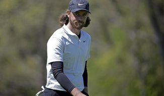 Tommy Fleetwood, of England, walks on the fourth green during the first round of the PGA Championship golf tournament, Thursday, May 16, 2019, at Bethpage Black in Farmingdale, N.Y. (AP Photo/Seth Wenig)