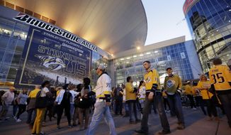 FILE - In this April 10, 2019, file photo, fans arrive at Bridgestone Arena for Game 1 of an NHL hockey first-round playoff series between the Nashville Predators and the Dallas Stars, in Nashville, Tenn. The Predators have agreed to a new 30-year lease deal that will help keep the franchise in Music City through 2049. (AP Photo/Mark Humphrey, File)