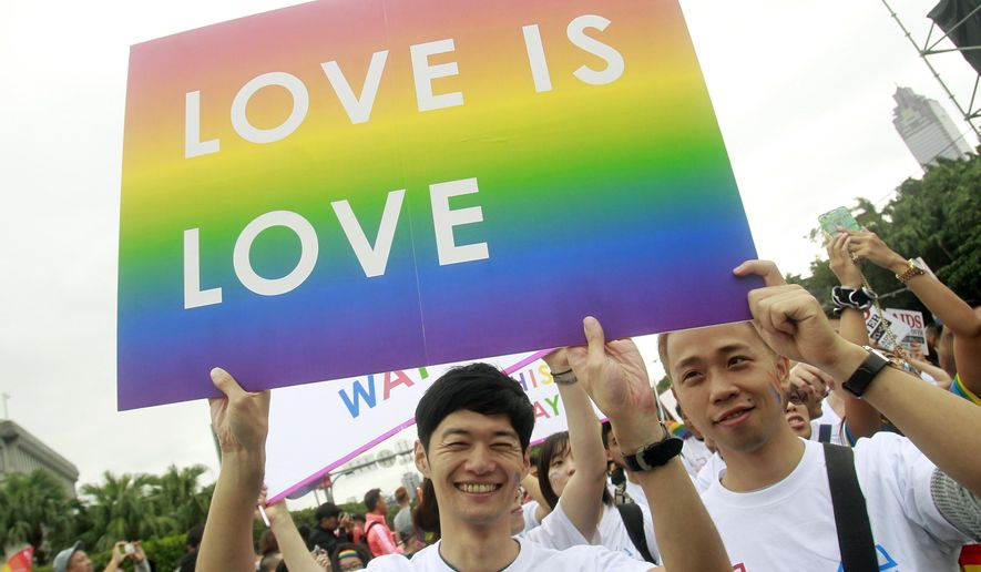 FILE - In this Saturday, Oct. 31, 2015, file photo, revelers participate in a gay pride parade in Taipei, Taiwan. Taiwanese legislators are scheduled to decide Friday on legalizing same-sex marriage, marking a potential first in Asia. (AP Photo/Chiang Ying-ying, File)