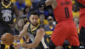 Golden State Warriors guard Stephen Curry, bottom, passes the ball as Portland Trail Blazers guard Damian Lillard (0) and center Enes Kanter defend during the second half of Game 2 of the NBA basketball playoffs Western Conference finals in Oakland, Calif., Thursday, May 16, 2019. (AP Photo/Jeff Chiu)