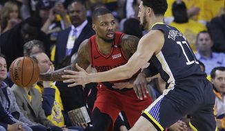 Portland Trail Blazers guard Damian Lillard, left, is defended by Golden State Warriors guard Klay Thompson during the first half of Game 2 of the NBA basketball playoffs Western Conference finals in Oakland, Calif., Thursday, May 16, 2019. (AP Photo/Jeff Chiu)