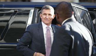 In this Dec. 18, 2018, file photo, President Donald Trump's former National Security Adviser Michael Flynn arrives at federal court in Washington. (AP Photo/Carolyn Kaster, File)