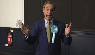Brexit Party leader Nigel Farage gestures, during his party's rally at the Corn Exchange, in Edinburgh, Friday May 17, 2019. (Tom Eden/PA via AP)