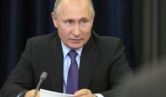 Russian President Vladimir Putin speaks during his meeting with scientists who received grants for scientific researche in Sochi, Russia. in the Bocharov Ruchei residence in the Black Sea resort of Sochi, Russia, Friday, May 17, 2019. (Alexei Druzhinin, Sputnik, Kremlin Pool Photo via AP)