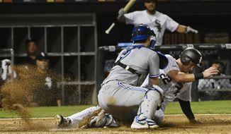 Chicago White Sox's Charlie Tilson (22) scores past Toronto Blue Jays catcher Danny Jansen during the eighth inning of a baseball game Thursday, May 16, 2019, in Chicago. (AP Photo/Matt Marton)