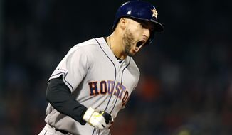 Houston Astros' George Springer reacts after hitting a two-run home run during the eighth inning of the team's baseball game against the Boston Red Sox in Boston, Friday, May 17, 2019. (AP Photo/Michael Dwyer)