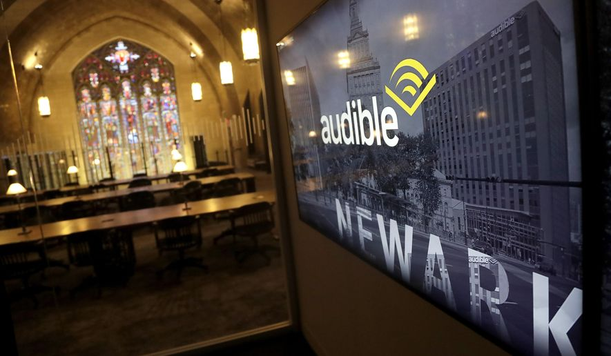 In this photo taken May 1, 2019, a monitor displays a logo inside a conference room near the library at the Audible offices in Newark, N.J. Audible's Newark offices are at the old Second Presbyterian Church. (AP Photo/Julio Cortez)