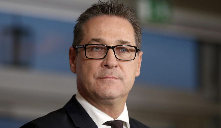 FILE - In this Dec. 16, 2017 file photo, Heinz-Christian Strache, chairman of the right-wing Freedom Party, FPOE, speaks at a news conference in Vienna, Austria. Two German newspapers are reporting that the head of Austria's far-right Freedom Party offered government contracts in return for support for his party from a potential Russian donor shortly before the Austrian's 2017 parliamentary election. (AP Photo/Ronald Zak,file)