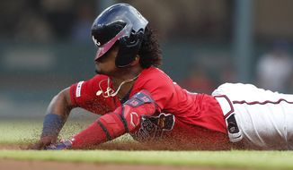 Atlanta Braves' Ronald Acuna Jr. (13) slides into second base with a double during the first inning of the team's baseball game against the Milwaukee Brewers on Friday, May 17, 2019, in Atlanta. (AP Photo/John Bazemore)