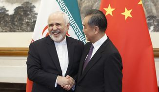 Chinese Foreign Minister Wang Yi meets Iranian Foreign Minister Mohammad Javad Zarif at the Diaoyutai State Guesthouse in Beijing, Friday, May 18, 2019. (Thomas Peter/Pool Photo via AP)