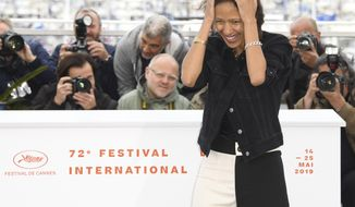 Director Mati Diop poses for photographers at the photo call for the film 'Atlantique' at the 72nd international film festival, Cannes, southern France, Friday, May 17, 2019. (Photo by Arthur Mola/Invision/AP)