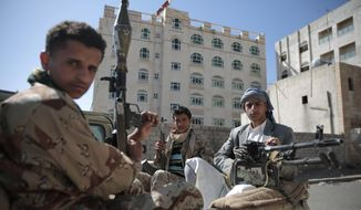 This Apr. 19, 2017 file photo, Shiite fighters, known as Houthis, pose for a photo as they secure a road, as people take part in a march from Sanaa to the port city of Hodeidah, Yemen.  (AP Photo/Hani Mohammed, File) **FILE**