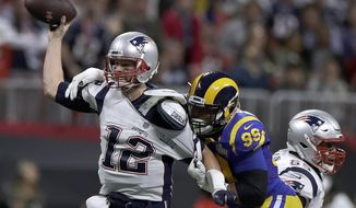 """File-This Feb. 3, 2019 file photo shows New England Patriots' Tom Brady (12) passing under pressure form Los Angeles Rams' Aaron Donald (99) during the first half of the NFL Super Bowl 53 football game in Atlanta. Brady will soon slip on his sixth Super Bowl ring, and Herb Adderley is the only other man on the planet who can relate to that level of success as the National Football League celebrates its 100th season.""""It's going to be a long time, another 100 years, before somebody wins himself six titles,"""" said Adderley, the Hall of Fame cornerback for Vince Lombardi's great Green Bay Packers teams of the 1960s. (AP Photo/Carolyn Kaster, File)"""