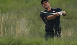 Adam Scott, of Australia, hits out of the rough on the 18th hole during the second round of the PGA Championship golf tournament, Friday, May 17, 2019, at Bethpage Black in Farmingdale, N.Y. (AP Photo/Andres Kudacki)
