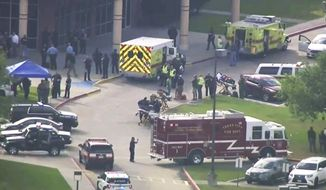 FILE - In this Friday, May 18, 2018 file image taken from video, emergency personnel and law enforcement officers respond to a high school near Houston after an active shooter was reported on campus, in Santa Fe, Texas. A year after the mass shooting at Santa Fe High School near Houston that remains one of the deadliest in U.S. history, Texas lawmakers are close to going home without passing any new gun restrictions, or even tougher firearm storage laws that Republican Gov. Greg Abbott had backed after the tragedy. (KTRK-TV ABC13 via AP, File)