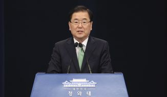 South Korean National Security Director Chung Eui-yong speaks during a briefing at the Presidential Blue House in Seoul, South Korea, Friday, May 17, 2019. Seoul and Abu Dhabi say that one South Korean and three Filipinos have been released following months of captivity in Libya. (Han sang-kyun/Yonhap via AP)
