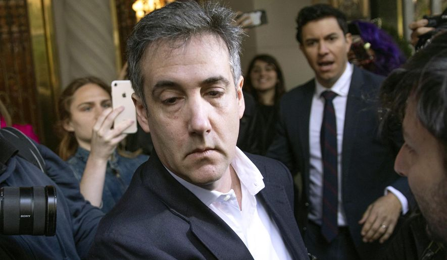 In this May 6, 2019, file photo, Michael Cohen, former attorney to President Donald Trump, leaves his apartment building before beginning his prison term in New York. Porn actress Stormy Daniels has agreed to dismiss a lawsuit that accused her former lawyer of colluding with Cohen to have her deny having an affair with Trump. A notice of agreement with Cohen and Daniels' ex-attorney, Keith Davidson, were filed Thursday, May 16, with a Los Angeles court. (AP Photo/Kevin Hagen, File)