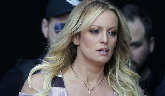 "In this Oct. 11, 2018, file photo, adult film actress Stormy Daniels arrives at the adult entertainment fair ""Venus"" in Berlin. (Associated Press)"