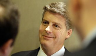 FILE - In this Nov. 18, 2015, file photo, New York Yankees owner Hal Steinbrenner smiles as he listens to a question while speaking with reporters at the baseball owners meeting in Dallas. Steinbrenner is pleased with the performance of his injury-decimated team. The Yankees have put 17 players on the injured list for 18 total stints. Still, they entered a three-game home series against AL East-leading Tampa Bay with a 26-16 record, a half-game behind the Rays.(AP Photo/LM Otero, File)