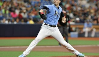 Tampa Bay Rays starter Blake Snell pitches against the New York Yankees during the first inning of a baseball game Sunday, May 12, 2019, in St. Petersburg, Fla. (AP Photo/Steve Nesius)