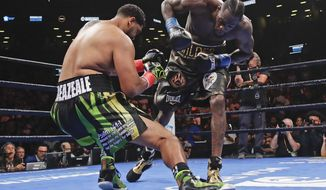 Deontay Wilder, right, knocks down Dominic Breazeale during the first round of the WBC heavyweight championship boxing match Saturday, May 18, 2019, in New York. Wilder stopped Breazeale in the first round. (AP Photo/Frank Franklin II)