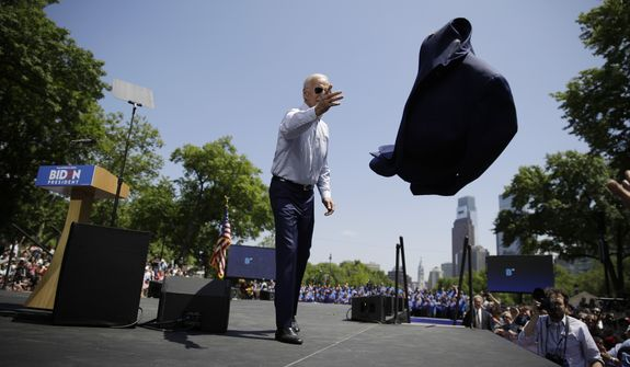 Democratic presidential candidate, former Vice President Joe Biden tosses his jacket to the side during a campaign rally at Eakins Oval in Philadelphia, Saturday, May 18, 2019. (AP Photo/Matt Rourke)