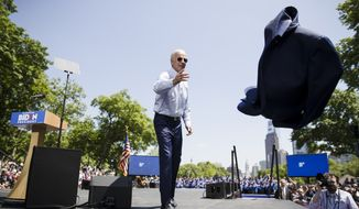 Democratic presidential candidate, former Vice President Joe Biden tosses his coat during a campaign rally at Eakins Oval in Philadelphia, Saturday, May 18, 2019. (AP Photo/Matt Rourke)